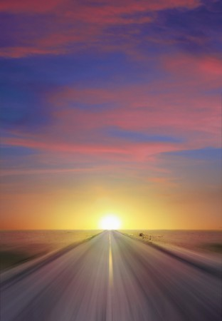 dirt road: Sun setting at thte end of a straight two lane highway cutting through a flat expanse of desert wasteland and vanishing to a point on the horizon