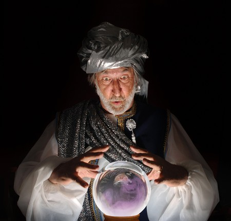 Swami gazing into a crystal ball Stock Photo - 9519798