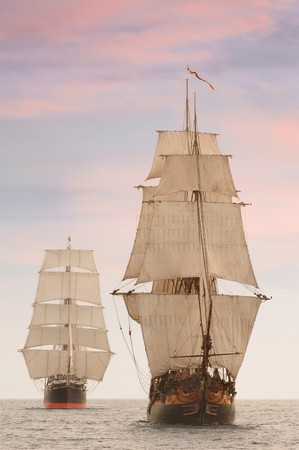 Tall wooden vintage sailing ships shot on the high seas from the front 版權商用圖片
