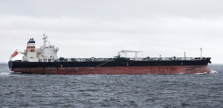 profile of an oil tanker heading out to sea Stock Photo