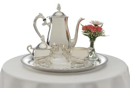 白い背景の上の銀のティー サービス 写真素材