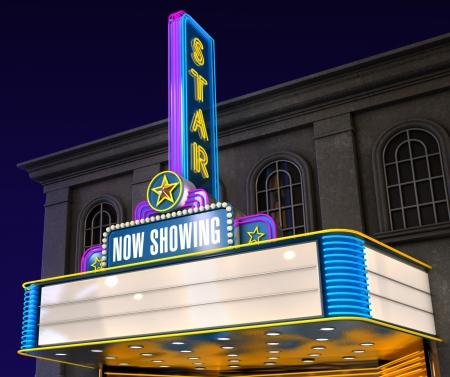 Exterior night shot of a retro illuminated neon movie theatre
