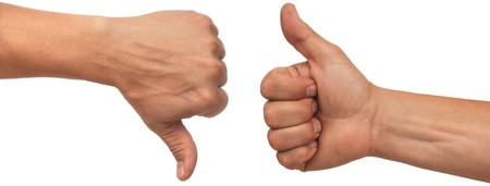 thumb up: two male hands with thumbs up and down on white background