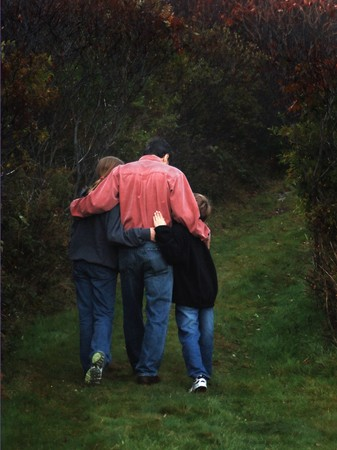 Father with two children walking in the woods photo