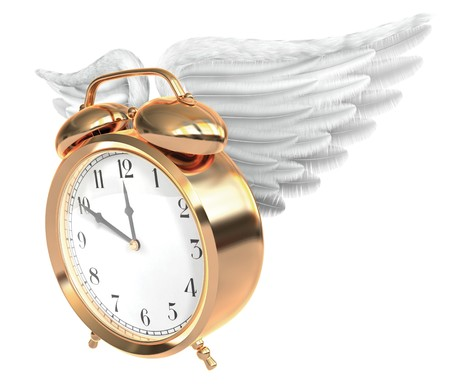 deadline: A Vintage brass alarm clock with feathered wings and bells on top