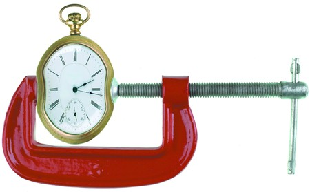 clamp: Clamp squeezing a clock on white Stock Photo