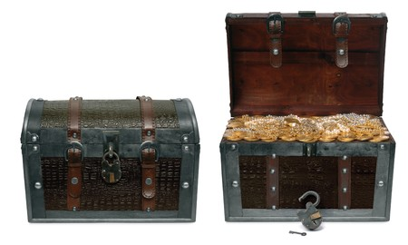 Two treasure chests isolated on a white background one in a closed position and the other open revealing treausre inside