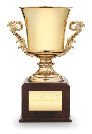 Classic gold trophy cup on wood pedestal with engraved inscription &quot,1st Place&quot, isolated on white background
