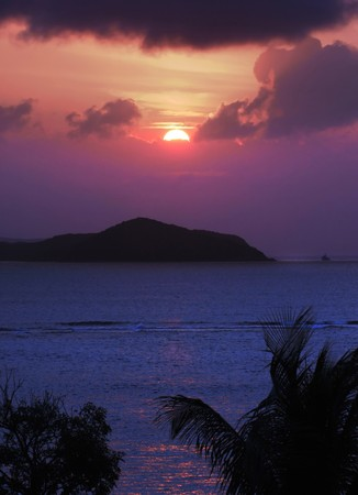 topical: Sun setting over  indigo blue waters of the Caribbean