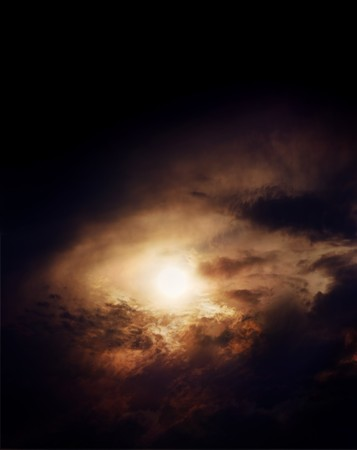 life after death: sun breaking through hole in dark clouds appearing as a portal to heaven Stock Photo
