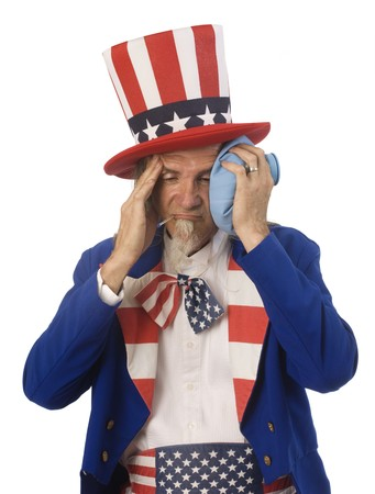 sam: Uncle Sam feeling sick with an oral thermometer and an ice bag shot on a white background Stock Photo