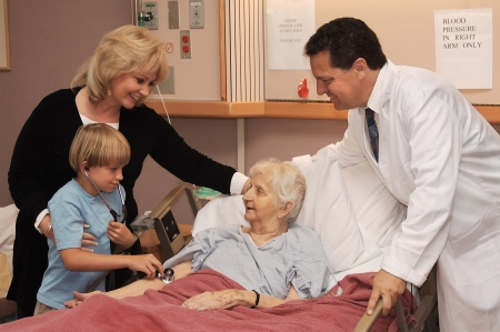 mother, son and doctor visiting grandmother in nursing home photo