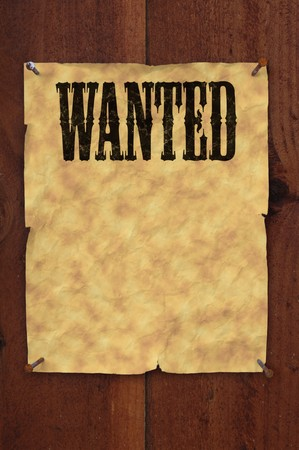 plackard: Old western style wanted poster nailed to a plank fence with blank space for copy