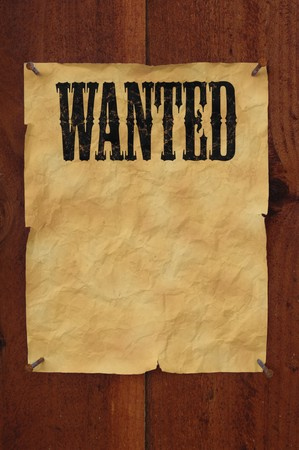 nails: Old western style wanted poster nailed to a plank fence with blank space for copy
