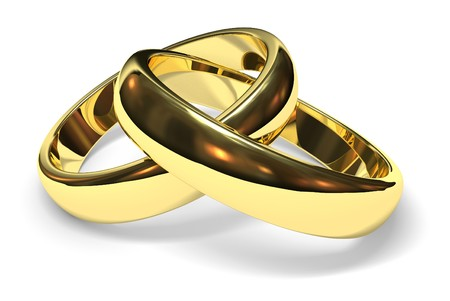 linked gold wedding rings on white background Stock Photo
