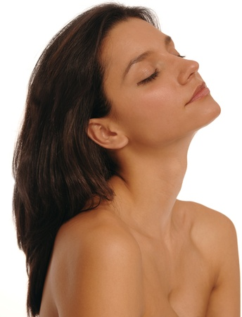 medium shot: Medium shot of a beautiful, young, brunette woman relaxing after a spa treatment