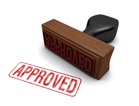 approved: Rubber stamp that says