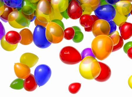 veelkleurige ballonnen omvallen van boven een witte achtergrond.  Stockfoto