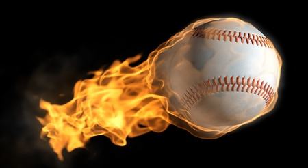 A base ball thats on fire flying through the air Stock Photo