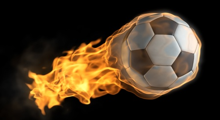 flaming: A Soccer ball thats on fire flying through the air
