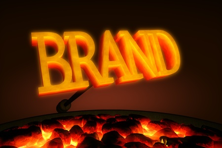 brand identity: Red hot branding iron with the word  Stock Photo