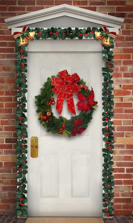 poinsettia: Christmas wreath hanging on a traditional wooden door decorated with a holly garland Stock Photo