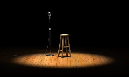 stool: Microphone stand and wooden stool under a spotlight on a stage