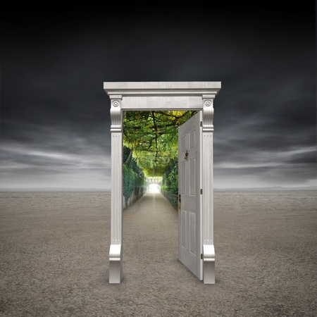Portal into another dimension represented by a doorway in the middle of a barren wasteland opening into a garden path with a light at the end photo
