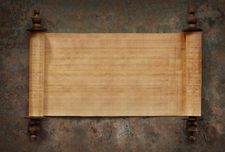 Ancient parchment scrolls with blank papyrus opened on a stone background
