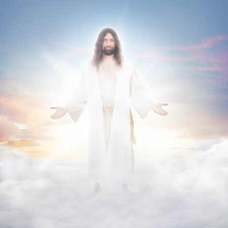 resurrected: Jesus resurrected in heavenly clouds bathed in luminous light