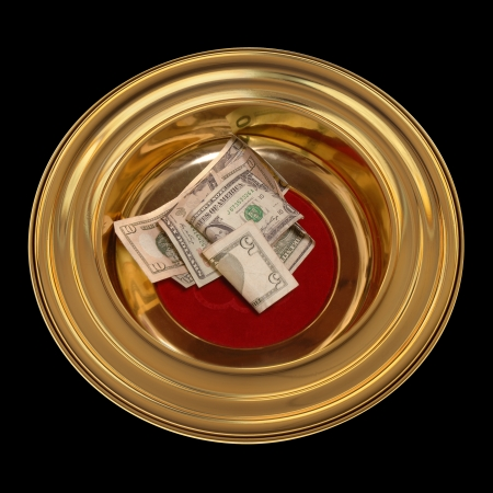 offering: Church offering plate with some currency in it