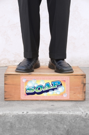 box: Man standing on a soap box