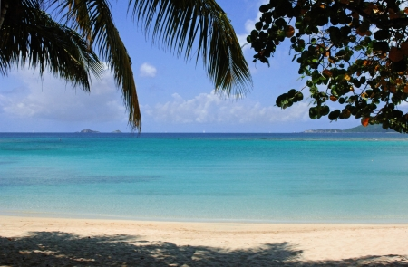 deserted: Image of tropical beach and islands on the horizon. Stock Photo