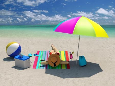 tote: Woman sunbathing on the beach under a beach umbrella Stock Photo