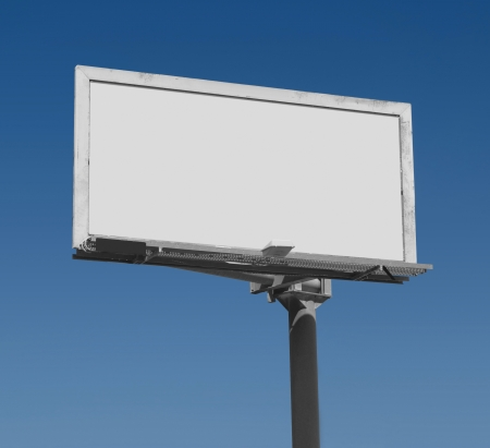 Blank freestanding billboard against a dark blue sky with clipping path for ad area Stock Photo