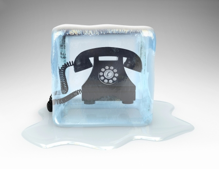 cold: Telephone frozen in a block of ice