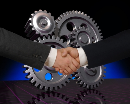 business handwhake with gears in the background