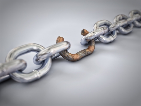 A chain with a broken link highlighted red to highlight the weak link. 스톡 콘텐츠