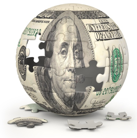mapped: Photo of a jigsaw sphere image mapped with a 100 dollar bill on a white backdrop