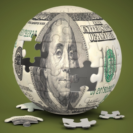 Photo of a jigsaw sphere image mapped with a 100 dollar bill on a green backdrop