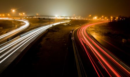 highway at night: Highway at night with traffic light lines at rush hour