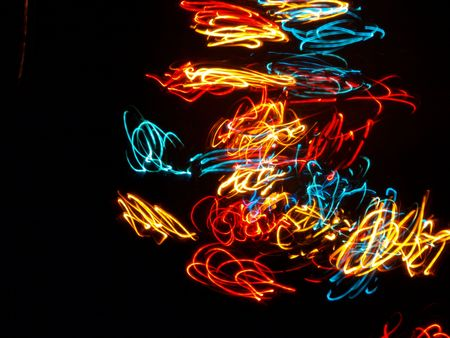 Multi colored abstract lights on black background � long time exposure photo