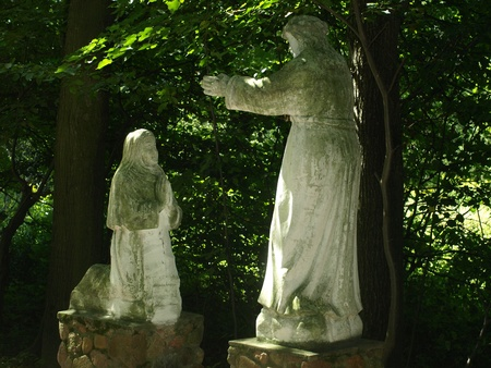 Stoned statues of saints in the shrine of the Holy Otylia in Urzedow, Poland Editorial