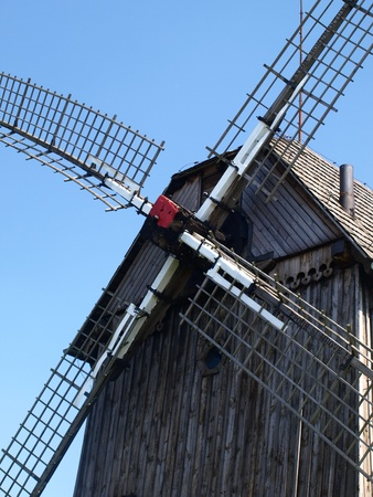 Old wooden windmill built in 1911 in Mecmierz, small village near Kazimierz Dolny in Poland photo