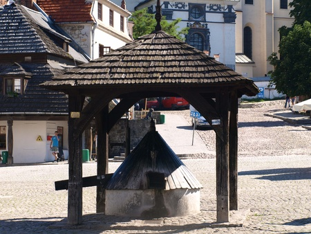 Old wooden well in Old Market Place in Kazimierz Dolny, Poland