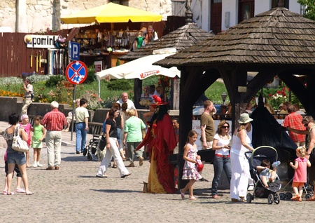 Street actor - witch on Old Market Place in Kazimierz Dolny, Poland