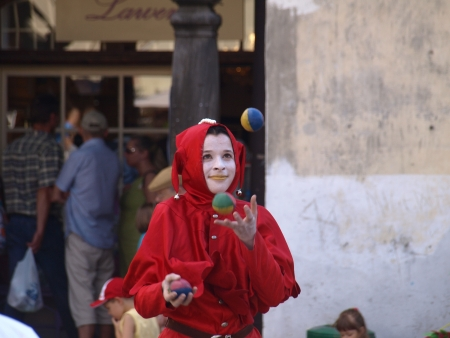 Street actor - juggler on Old Market Place in Kazimierz Dolny, Poland