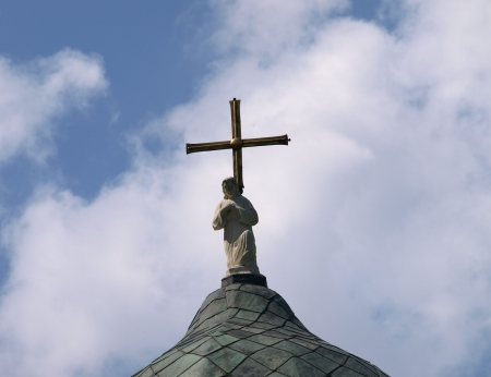 Figure of Jesus Christ on church s roof Stock Photo