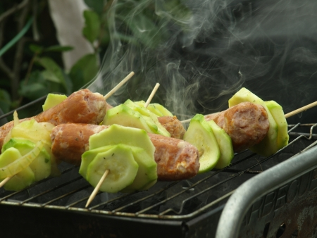 Sausages with vegetables on barbaque photo