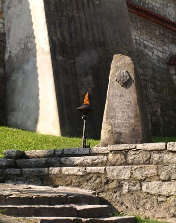 Kazimierz Dolny, Poland - August 15, 2010: Eternal Flame memorial near patriotic statue near patriotic statue in Kazimierz Dolny, Poland